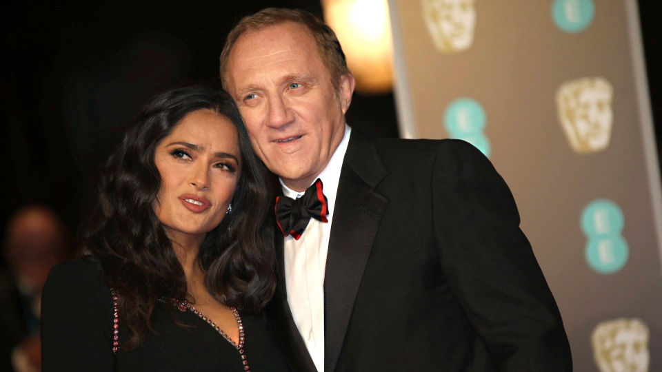 Actress Salma Hayek and husband Francois-Henri Pinault pose for photographers upon arrival at the BAFTA Awards 2018 in London, Sunday, Feb. 18, 2018. (Photo by Vianney Le Caer/Invision/AP)