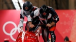 Driver Justin Kripps and Alexander Kopacz of Canada start their first run during the two-man bobsled competition at the 2018 Winter Olympics in Pyeongchang, South Korea, Sunday, Feb. 18, 2018. (AP Photo/Andy Wong)