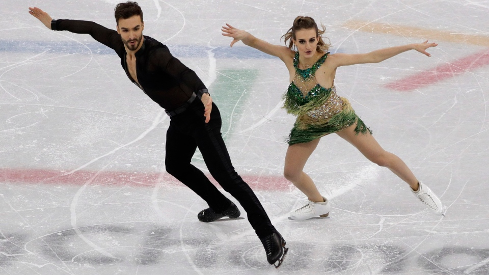 Gabriella Papadakis and Guillaume Cizeron of France perform during the ice dance, short dance figure skating in the Gangneung Ice Arena at the 2018 Winter Olympics in Gangneung, South Korea, Monday, Feb. 19, 2018. (AP Photo/David J. Phillip)