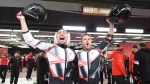 Canadians Justin Kripps, right, and Alexander Kopacz celebrate their tie with Germany for the gold medal after the men's two-man bobsled finals at the 2018 Winter Olympic Games in Pyeongchang, South Korea, Sunday, Feb. 18, 2018. (THE CANADIAN PRESS/Jonathan Hayward)
