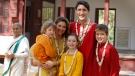 Prime Minister Justin Trudeau, his wife, Sophie Gregoire Trudeau, their sons Hadrien and Xavier, right, daughter Ella-Grace, center front, pose for the photographers at the Sabarmati Ashram or Mahatma Gandhi Ashram in Ahmadabad, India, Monday, Feb. 19, 2018. (AP Photo/Ajit Solanki)