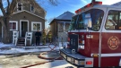 Fire crews work to put out hot spots after a fire in a home in the 1600 block of Toronto Street on Feb. 19, 2018 (Gareth Dillistone / CTV Regina)