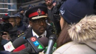 Chief Mark Saunders speak with Jelena Leung, the concerned wife of a police officer, outside Toronto Police Headquarters Monday February 19, 2018.