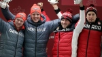 From left, driver Francesco Friedrich and Thorsten Margis of Germany and driver Justin Kripps and Alexander Kopacz of Canada celebrate during the two-man bobsled final at the 2018 Winter Olympics in Pyeongchang, South Korea, Monday, Feb. 19, 2018. The two countries tied for a gold medal. (AP Photo/Michael Sohn)
