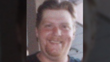 Donald Kelly, 45, is seen in this image provided by the Integrated Homicide Investigation Team.