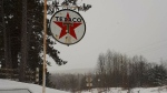 This Texaco  sign was stolen in Anten Mills, Ont. It can be seen in this undated photo. (Nancy Priest-Coutt/ Facebook)