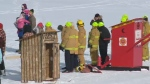 Competitors in the outhouse races at Waskimo wait at the start line on Feb. 19, 2018