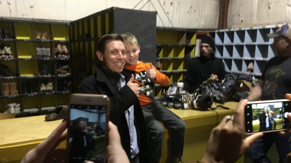 Patrick Brown takes photos at an event in Orillia, Ont. on Monday, Feb. 19, 2018. (Mike Arsalides/ CTV Barrie)