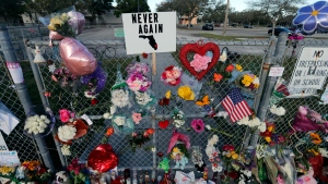 A makeshift memorial is seen outside the Marjory Stoneman Douglas High School, where 17 students and faculty were killed in a mass shooting on Wednesday, in Parkland, Fla., Monday, Feb. 19, 2018. (AP Photo/Gerald Herbert)