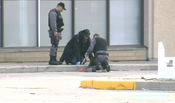 Toronto police investigate at the scene of the shooting in Scarborough, Tuesday, May 19, 2009.