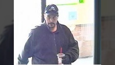 Mounties in Nanaimo are searching for a man accused in a weekend bank robbery that was caught on surveillance cameras. Feb. 17, 2018. (Police Handout)