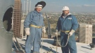 John Graham Hulme and a fellow welder atop the Calgary Tower in the fall of 1987 during the installation of the torch (supplied)