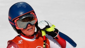 Switzerland's Lara Gut pauses after finishing women's downhill training at the 2018 Winter Olympics in Jeongseon, South Korea, Monday, Feb. 19, 2018. (AP Photo/Christophe Ena)