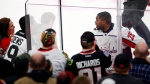 Washington Capitals right wing Devante Smith-Pelly (25) argues with Chicago Blackhawks fans from the penalty box during the third period of an NHL hockey game Saturday, Feb. 17, 2018, in Chicago. (Jeff Haynes/AP Photo)