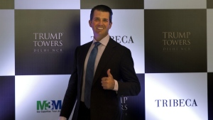 Donald Trump Jr. gives a thumbs up as he arrives for a meeting in New Delhi, India, Tuesday, Feb. 20, 2018. (AP Photo/Manish Swarup)