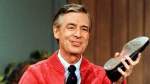 Fred Rogers is seen as he rehearses the opening of his PBS show 'Mister Rogers' Neighborhood' during a taping in Pittsburgh on June 28, 1989. (AP Photo/Gene J. Puskar, File)