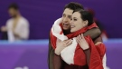 Tessa Virtue and Scott Moir celebrate during the venue ceremony after winning the gold medal in the ice dance, free dance figure skating final in the Gangneung Ice Arena at the 2018 Winter Olympics in Gangneung, South Korea on Tuesday, Feb. 20, 2018. (AP Photo/David J. Phillip)