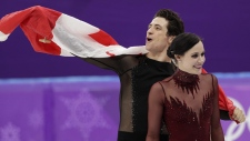 Tessa Virtue and Scott Moir during the venue ceremony after winning the gold medal in the ice dance, free dance figure skating final on Feb. 20, 2018. (David J. Phillip / AP)