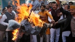 India's opposition Congress party supporters shout slogans as they burn an effigy of Prime Minister Narendra Modi as they protest against the alleged US$1.8 billion bank fraud in Lucknow, India, Tuesday, Feb. 20, 2018. (AP Photo/Rajesh Kumar Singh)