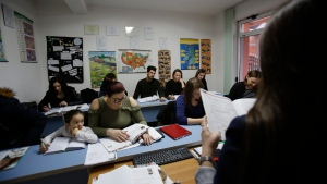 In this photo taken Tuesday Feb. 6, 2018, Bosnian people attend a German language class in Kalesija, Bosnia. Bosnia, which suffered a bloody civil war in the 1990s, has the world's highest rate of youth unemployment hovering at some 65 percent, forcing young and old alike, to look elsewhere for work. (AP Photo/Amel Emric)