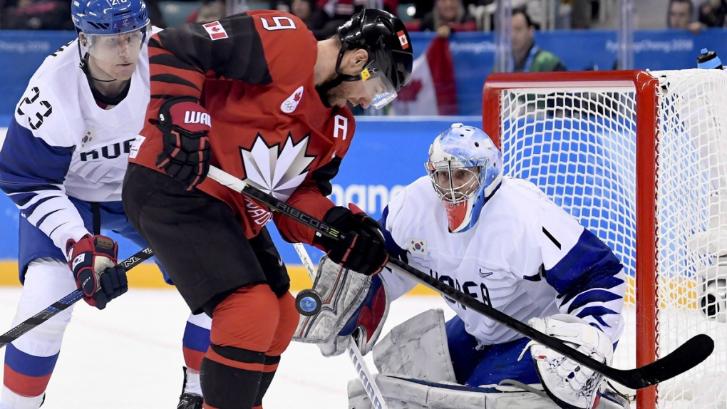 Canada forward Derek Roy vies for the puck