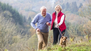 A few hours a week of light exercise -- walking the dog, puttering about in the garden -- lower the risk of death in older men. (SolStock/Istock.com)