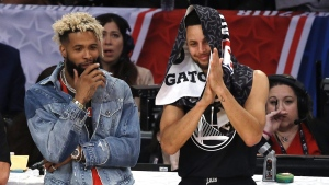 NFL player Odell Beckham Jr., left, stands with Stephen Curry at the NBA All-Star Game on Feb. 18, 2018. (Alex Gallardo / AP)