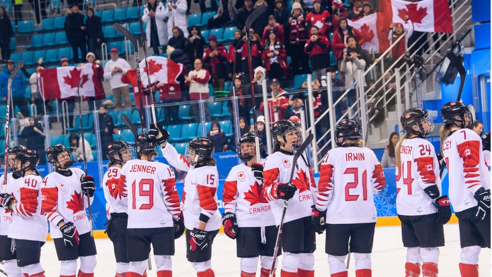 Canadian players celebrate their victory over the team from Russia at Gangneung Hockey Centre on Feb. 19, 2018.  (THE CANADIAN PRESS/HO-COC/Vincent Ethier)