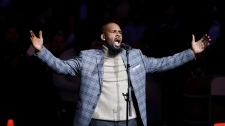 In this Nov. 17, 2015 file photo, R. Kelly performs the national anthem before an NBA basketball game between the Brooklyn Nets and the Atlanta Hawks in New York. (AP Photo/Frank Franklin II, File)