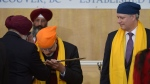 Indian Prime Minister Narendra Modi, left, accepts a ceremonial kirpan while Prime Minister Stephen Harper looks on at the Gurdwara Khalsa Diwan in Vancouver on Thursday, April 16, 2015. (THE CANADIAN PRESS/Jonathan Hayward)