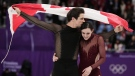 Tessa Virtue and Scott Moir of Canada celebrate after winning the gold medal in the ice dance, free dance figure skating final in the Gangneung Ice Arena at the 2018 Winter Olympics in South Korea, Feb. 20, 2018. (AP/Julie Jacobson)