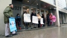 Parents and family members of children with autism protest outside Youth protection minister Lucie Charlebois's Montreal offices on Feb. 20, 2018