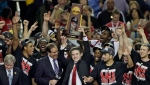 In this April 8, 2013, file photo, Louisville players and head coach Rick Pitino celebrate after defeating Michigan 82-76 in the championship of the Final Four in the NCAA college basketball tournament in Atlanta. (AP Photo/Chris O'Meara, File)