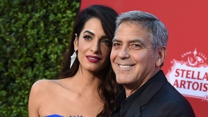 "FILE - In this Oct. 22, 2017 file photo, Amal Clooney and George Clooney arrive at the premiere of ""Suburbicon"" in Los Angeles. (Photo by Jordan Strauss/Invision/AP, File)"