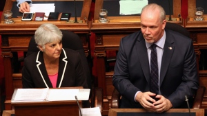 Finance Minister Carole James and Premier John Horgan look on before the budget speech from the legislative assembly at Legislature in Victoria, B.C., on Tuesday, February 20, 2018. THE CANADIAN PRESS/Chad Hipolito