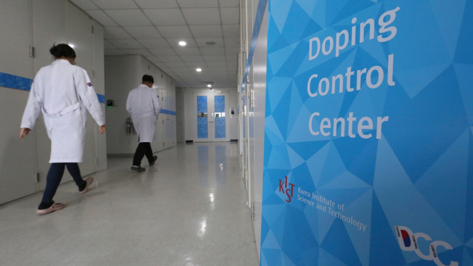 Researches enter into the Doping Control Center at the Korea Institute of Science and Technology in Seoul, South Korea, Monday, Feb. 19, 2018. (AP Photo / Ahn Young-joon)