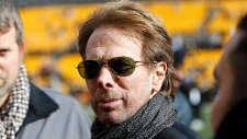 FILE - In this Sunday, Jan. 14, 2018 file photo, movie producer Jerry Bruckheimer stands on the sidelines before an NFL divisional football AFC playoff game. (AP Photo/Keith Srakocic)