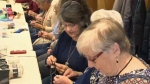 Seniors knitting for third world children