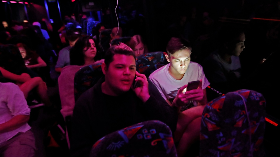 Student survivors from Marjory Stoneman Douglas High School, where 17 students and faculty were killed in a mass shooting last Wednesday, ride during the night aboard their bus between Parkland, Fla., and Tallahassee, Fla., Tuesday, Feb. 20, 2018, to rally outside the state capitol and talk to legislators about gun control reform. (AP Photo / Gerald Herbert)