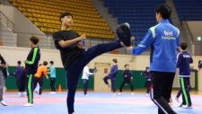 Athlete-soldiers train in taekwondo at the Korea Armed Forces Athletic Corps base in Mungyeong, South Korea. (CTV News)