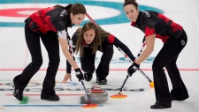 Canada skip Rachel Homan, lead Lisa Weagle, left, and second Joanne Courtney, play against Eve Muirhead of Great Britian at the 2018 Winter Olympics in Gangneung, South Korea, Wednesday, February 21, 2018. (THE CANADIAN PRESS/ HO-WCF/Curling Canada/Michael Burns)