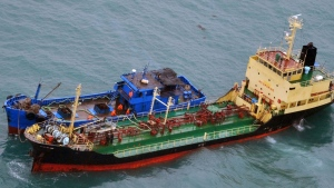 This Feb. 16, 2018 photo released by Japan's Ministry of Defense, shows what it says North Korean-flagged tanker Yu Jong 2, bottom, and Min Ning De You 078 lying alongside in the East China Sea. (Ministry of Defense via AP)