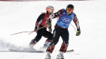 Brady Leman, of Canada, and Armin Niederer, of Switzerland, finish their heat during the men's ski cross semifinal at Phoenix Snow Park at the 2018 Winter Olympics in Pyeongchang, South Korea on Wednesday, Feb. 21, 2018. (AP Photo/Kin Cheung)