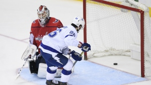 Tampa Bay Lightning right wing Nikita Kucherov scores a goal against Washington Capitals goaltender Braden Holtby during the third period of an NHL hockey game in Washington on Tuesday, Feb. 20, 2018. (AP Photo/Nick Wass)