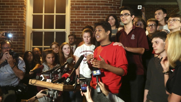 Tanzil Philip, 16, Coral Springs, a sophomore at Marjory Stoneman Douglas High School, centre, addresses the crowd outside of Leon High School in Tallahassee, Fla. on Feb. 20, 2018. (Scott Keeler/Tampa Bay Times via AP)