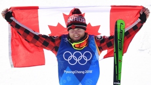 Brady Leman of Canada celebrates his gold medal in the men's ski cross at the 2018 Winter Olympic Games in Pyeongchang, South Korea, Wednesday, Feb. 21, 2018. THE CANADIAN PRESS/Jonathan Hayward