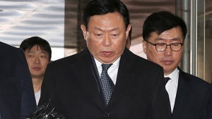 In this Tuesday, Feb. 13, 2018, file photo, Lotte's Shin Dong-bin, center, a son of Lotte's founder, who was charged with bribery, arrives at the Seoul Central District Court in Seoul, South Korea. (Ha Sa-hun / Yonhap via AP, File)