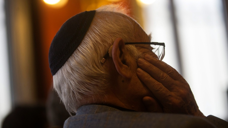A man wearing a Jewish yarmulke listens during a news conference at the Royal Spanish Academy in Madrid, Tuesday, Feb. 20, 2018.(AP Photo/Francisco Seco)