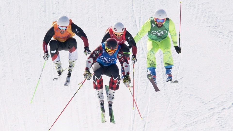 Brady Leman races with Marc Bischofbberger, Armin Niederer and Filip Flisar during the men's ski cross at Phoenix Snow Park on Feb. 21, 2018. (Jonathan Hayward / THE CANADIAN PRESS)