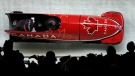 Driver Kaillie Humphries and Phylicia George of Canada take a curve in their third heat during the women's two-man bobsled final at the 2018 Winter Olympics in Pyeongchang, South Korea, Feb. 21, 2018. (AP Photo/Michael Sohn)
